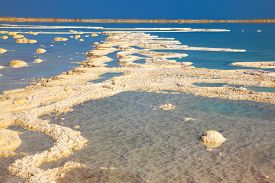 stock photo of crystal salt  -  The picturesque road from the evaporated salt in the Dead Sea - JPG