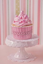 pic of sugarpaste  - Pink cupcakes on a striped background - JPG