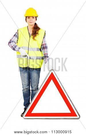Young Woman In Construction Helmet With Road Sign