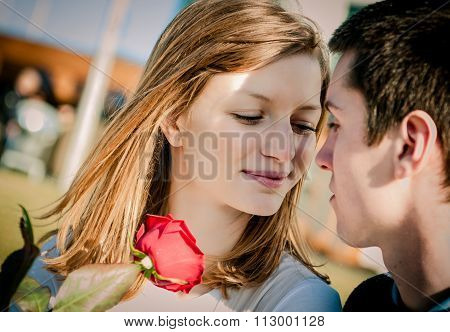 Young couple - woman with red rose