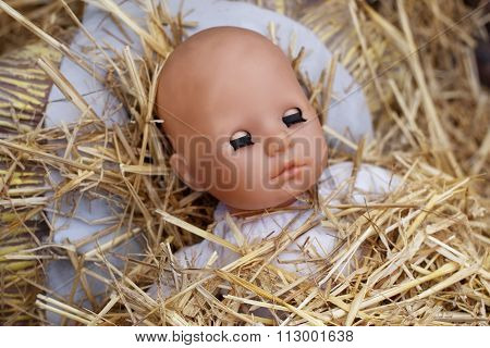 Doll And Straw In A Manger