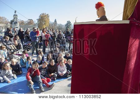 Children Enjoying With Puppet Theatre Performance In Retiro Park, Madrid