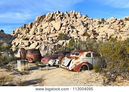 JOSHUA TREE, CALIFORNIA - JANUARY 1, 2016: Junk cars at Keys Ranch. In Joshua Tree National Park, the cars were collected by homesteader Bill Keys.