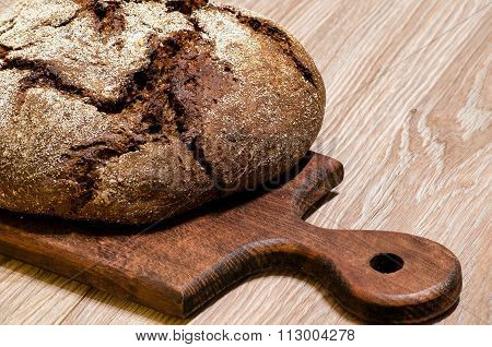 Rye Bread With Caraway Seeds On The Kitchen Blackboard