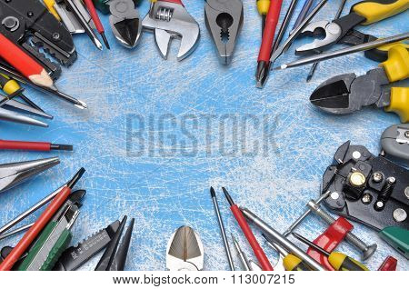 Set of electrical tool for use in electrical installations on blue metal surface