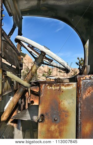 Closeup of an antique and rusted out truck at Keys Ranch in Joshua Tree National Park.