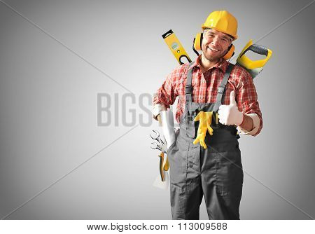 Builder in yellow helmet
