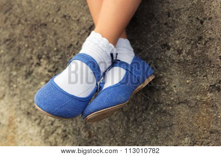 Close up of blue denim ballerinas  on child's feet