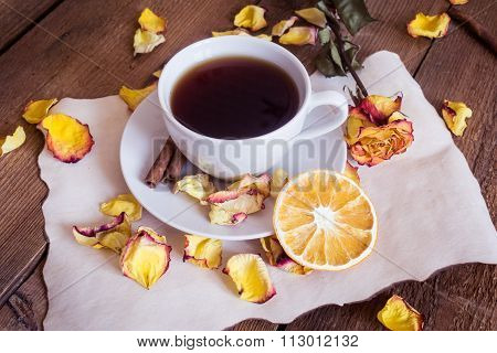 Cup Of Tea, Dried Oranges, Dried Rose Petals On Wooden Background