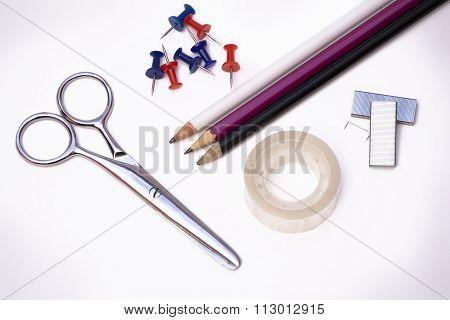 Scissors, Tape, Pencils And Tacks.