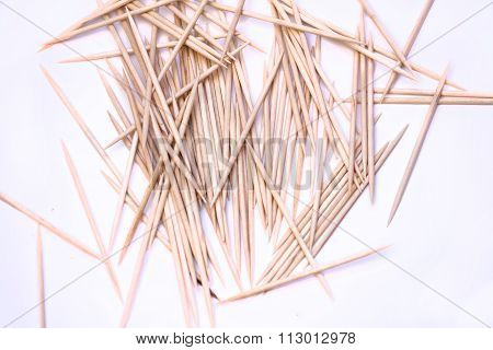 A Lot Of Toothpicks On A White Background.