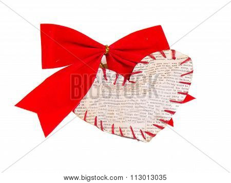 The Self-made Heart Sewed From A Newspaper Slice On A Red Bow Is Isolated On A White Background