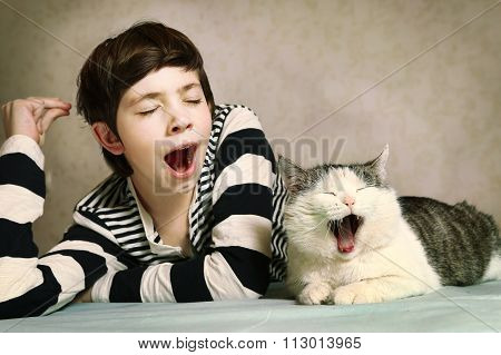 Boy In Striped Blouse And Siberian Cat