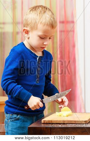 Child Cut Apple With A Kitchen Knife, Cooking.