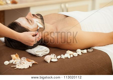 Skillful therapist is working at beauty salon