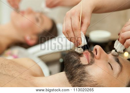 Beautiful loving couple is resting at beauty salon