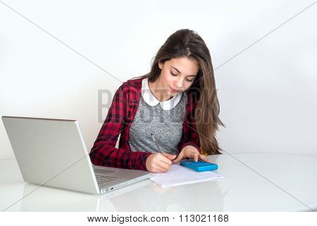 young girl studying with pocket calculator