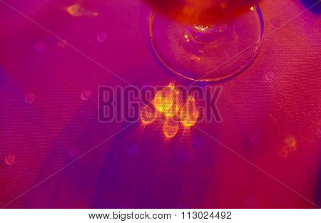 light reflection on cloth with champagne glass.