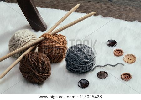 Button And Woolen Yarn Ball On Carpet