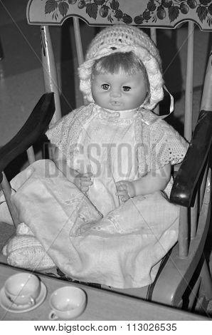 Antique doll in rocker