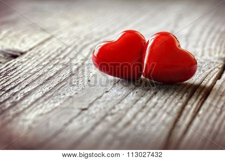 Two hearts on a wooden background concept for love, dating and romance with copyspace