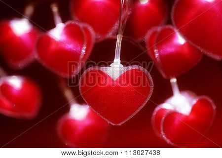 Red heart fairy lights valentine's day background or abstract love, dating and romance concept
