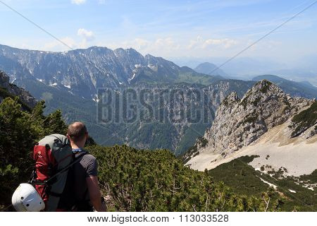 Mountaineer in front of the Wild Kaiser mountains
