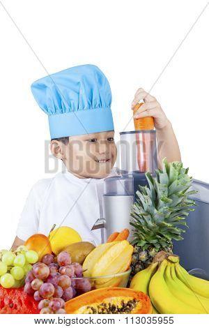 Cute Boy Making Fruit Juice