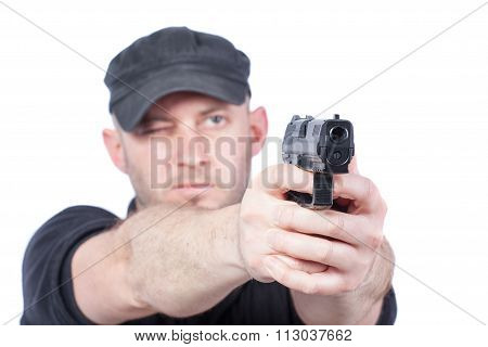 Man Pointing Gun, Isolated On White. Focus On The Gun
