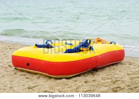 Red Yellow Air Mattress  At A Beautiful Beach With A Sea