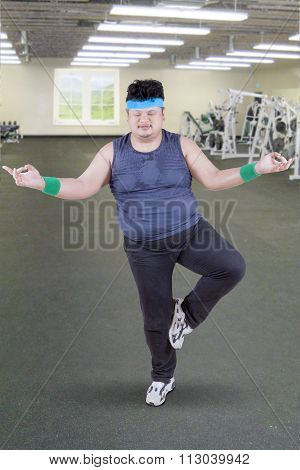 Overweight Man Doing Yoga Pose