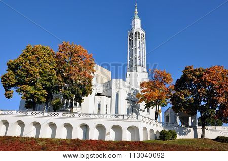 Modern White Catholic Church in automn