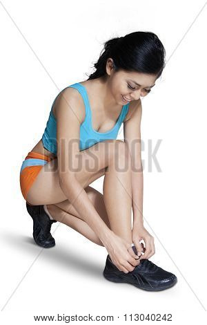 Pretty Woman Tying Her Shoelaces