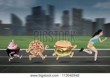 Young Woman Chased By Junk Food