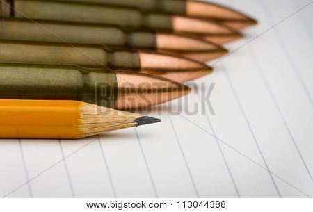Pencil And Cartridges On Notepad