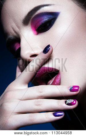 Beautiful girl with bright creative fashion makeup and colorful nail polish. Art beauty design.
