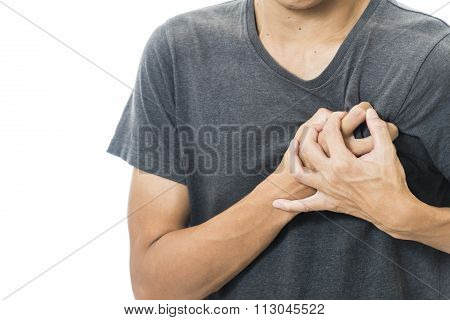 man feeling heart pain and holding her chest