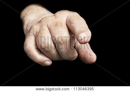 One senior hand on a black background
