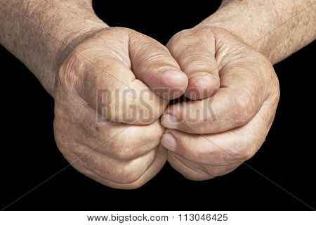 Two senior hands on a black background
