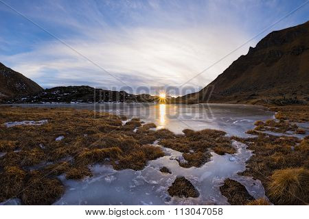 High Altitude Frozen Alpine Lake, Reflections At Sunset