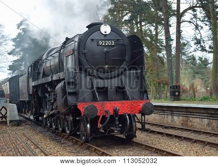 British Railways Standard Class 9F 2-10-0 steam locomotive 92203 Black Prince at  Holt station on t