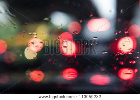 Defocussed Traffic Viewed Through A Car Windscreen During The Rain