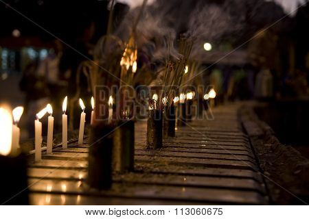 Burning Incense Sticks And Candle