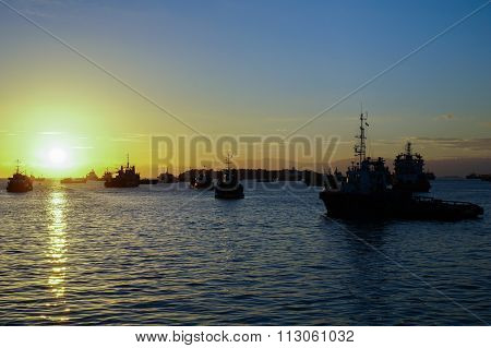 LABUAN FT, MALAYSIA - DEC 26, 2015 : Silhouette Of The Supply Vessels At Sunrise.