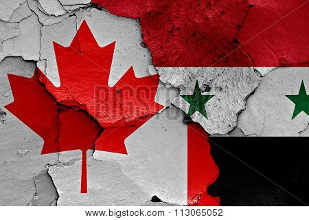 Flags Of Canada And Syria Painted On Cracked Wall