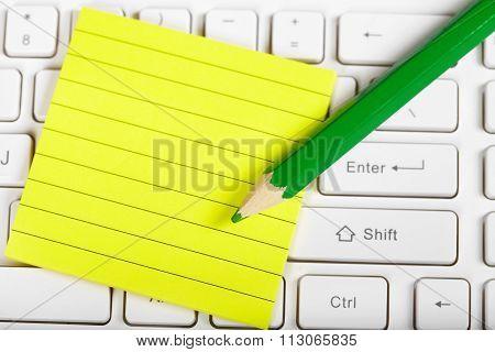Green Pensil And Keyboard