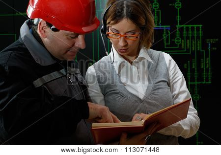 Woman Is Giving Instructions To Worker In Power Plant