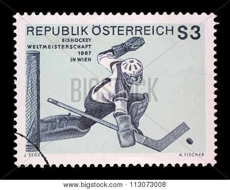 AUSTRIA - CIRCA 1967: A stamp printed by AUSTRIA shows image of Ice Hockey Goaltender, Hockey championship in Wien, circa 1967