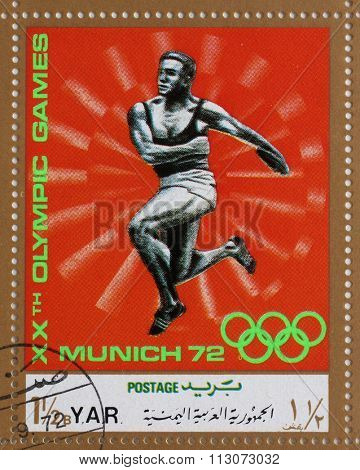 YAR - CIRCA 1972: A stamp printed in Yemen Arab Republic shows competition in the discus throw, Olympics in Munich, circa 1972