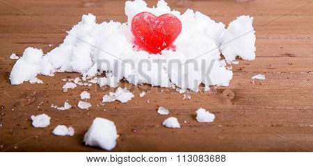 Bright Red Ice Heart On A Hill Of White Snow